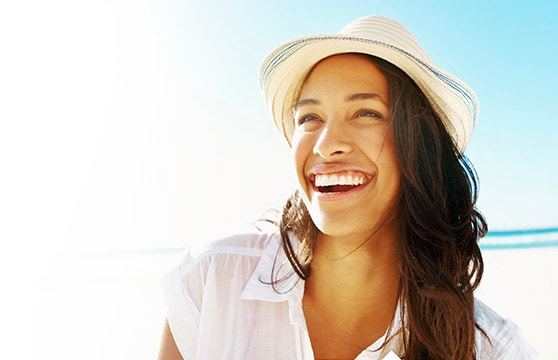 image of smiling woman on beach