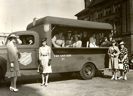 Ladies from the General Office, Toronto, Ontario, presenting a Mobile Tea Canteen to the Salvation Army for the war effort on June 25, 1941. Photograph taken by Alan Walker - Toronto, Ontario, June 1941.