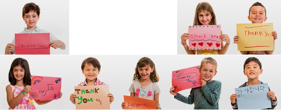 Children holding Thank You signs