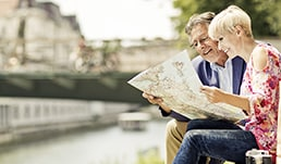A couple looking at a map by the Seine