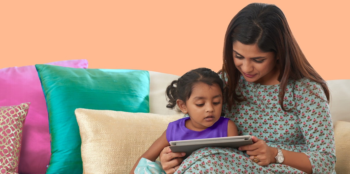 Decorative: woman and daugther reading on a tablet