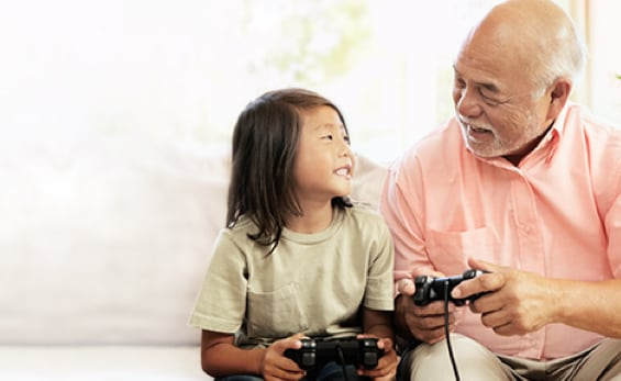 Grandfather and grandson playing video games
