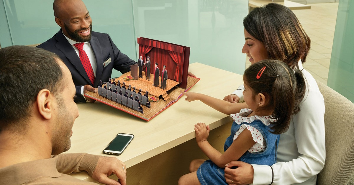 A family sitting with a financial advisor in a Scotiabank branch