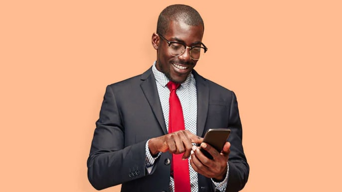 man in a suit with smartphone