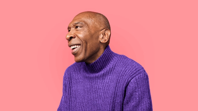 man in a purple sweater