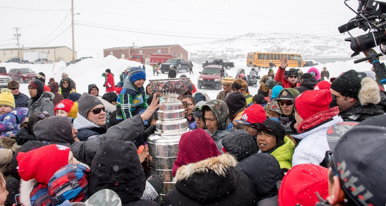 Excited residents surrounded the Stanley Cup® as soon as it arrived in Cape Dorset. Image courtesy of Michelle Valberg.