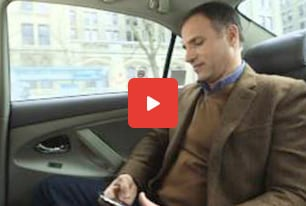 man in car getting alerts on mobile phone
